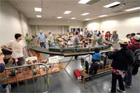 Early on Maker Faire's Saturday; BAGRS member David Wegmueller is standing to the left. Photo by Mike Martin.
