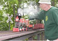 Ernie Noa of Monticello, Ill., tends to his British 0-6-0 on the outside track, while Scott McDonald's 1860s-era 4-4-0 chugs through on the inside.